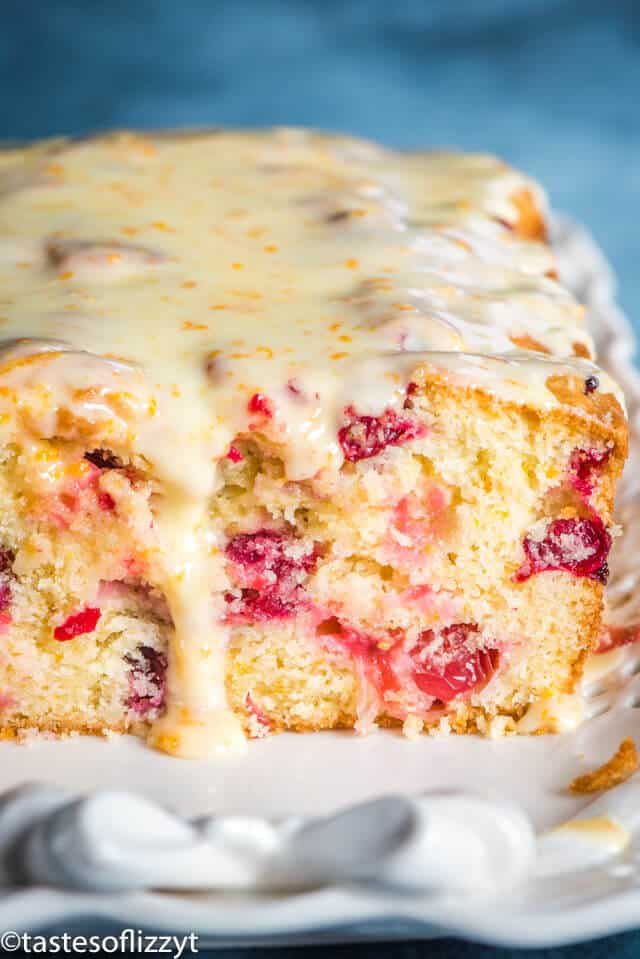 A close up of cranberry orange bread with glaze