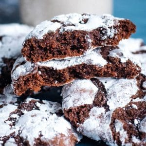 chocolate crinkle cookies broken in half to reveal the inside
