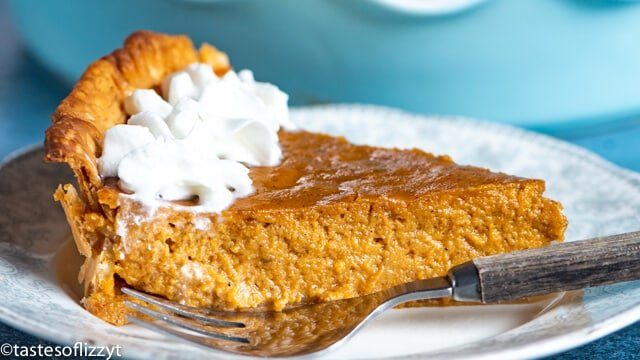 A piece of eggnog pumpkin pie on a plate with a fork