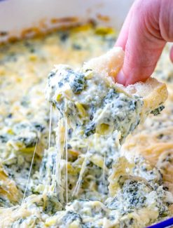 crostini bread in spinach artichoke dip