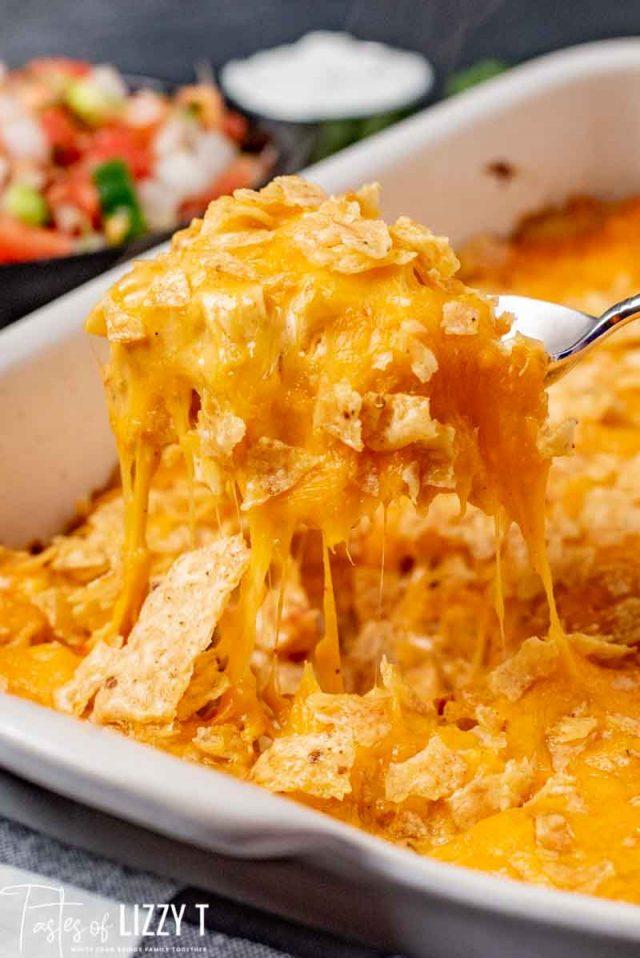 A close up of a cheesy chicken casserole