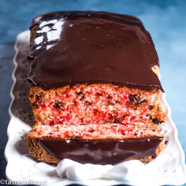 cherry quick bread with chocolate glaze on a plate