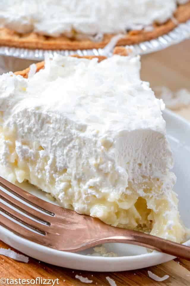 A piece of coconut cream pie on a plate