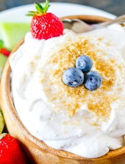 bowl of fruit dip with blueberry and strawberry