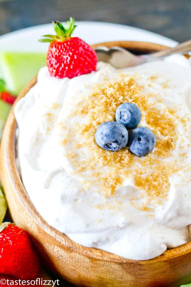 A close up of fluffy fruit dip with brown sugar