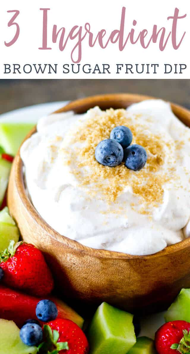 A close up of a bowl of fruit dip, with Cool Whip and Sour cream