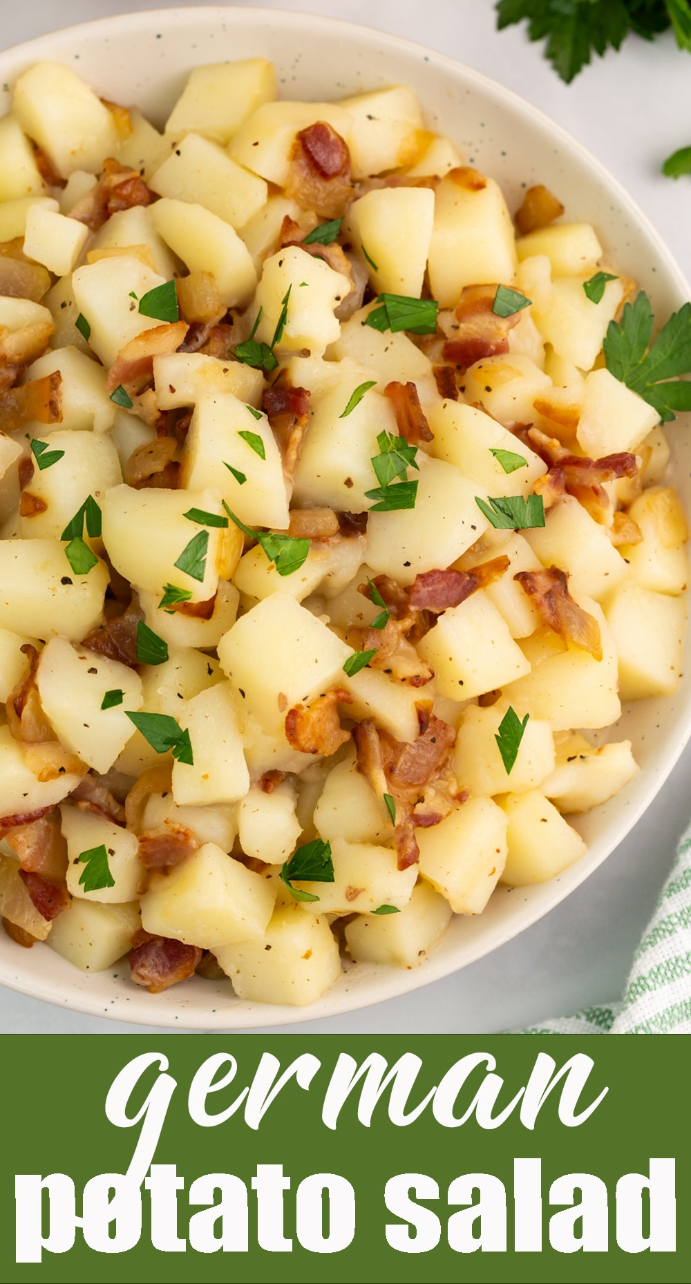 Bacon, apple cider vinegar, onion and sugar give this German potato salad a kick! Traditionally served warm, this potato side dish is salty and sweet. via @tastesoflizzyt