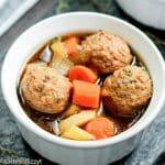 A bowl of soup, with Meatball and Potato
