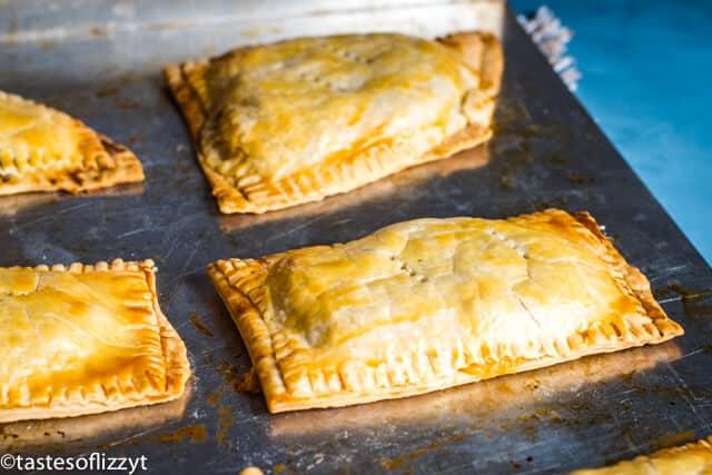 sausage hand pies on baking sheet
