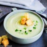 bowl of potato leek soup with croutons