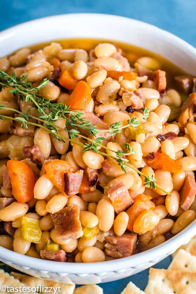 A bowl of beans and ham