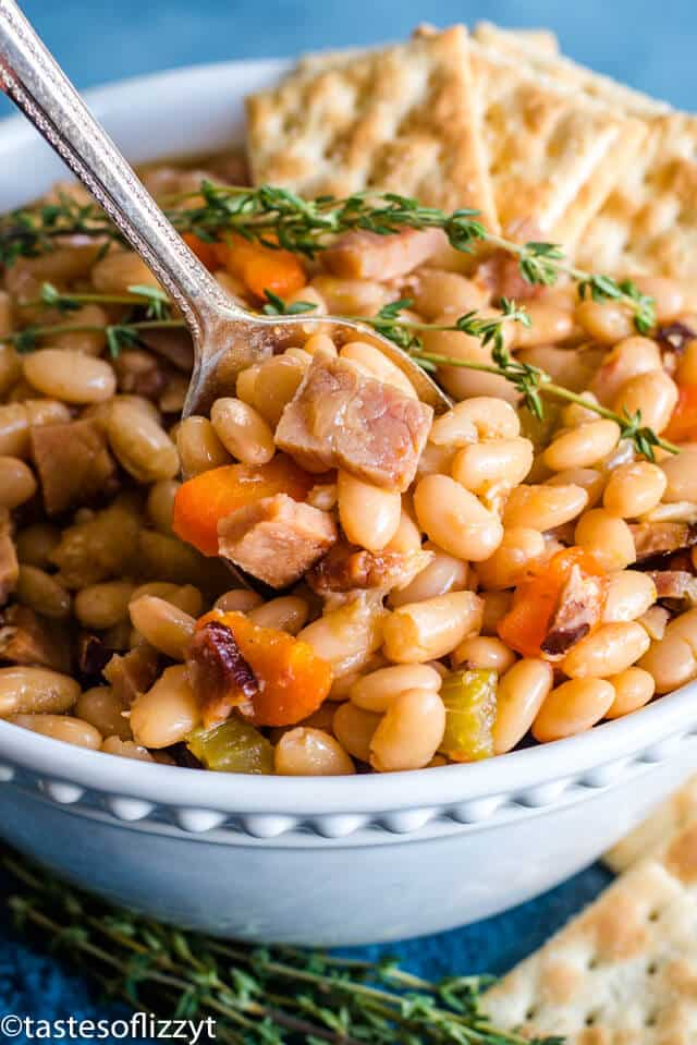 A bowl of food, with Ham and beans
