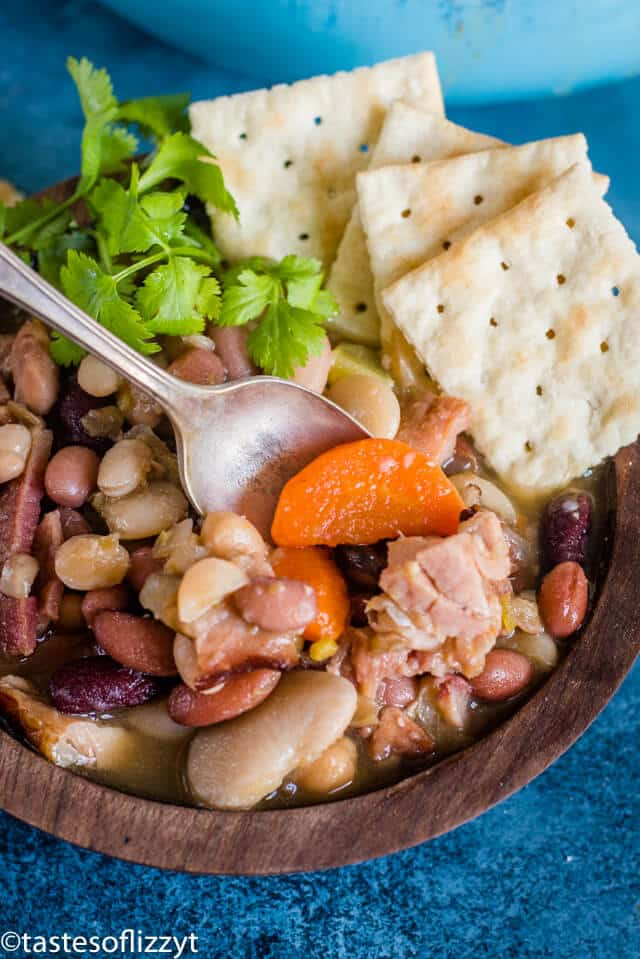 A plate of food, with Ham, beans and crackers