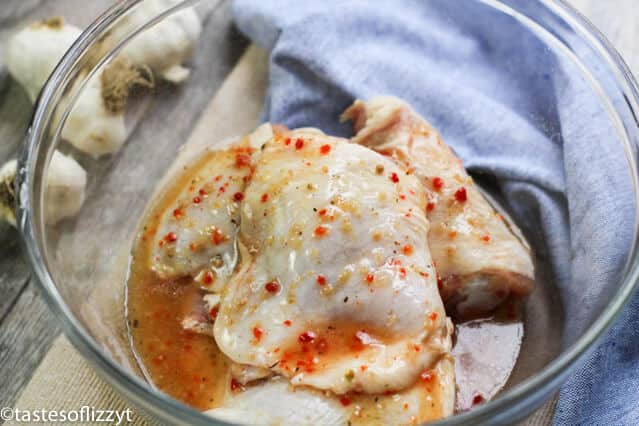 chicken thighs marinating in Italian salad dressing