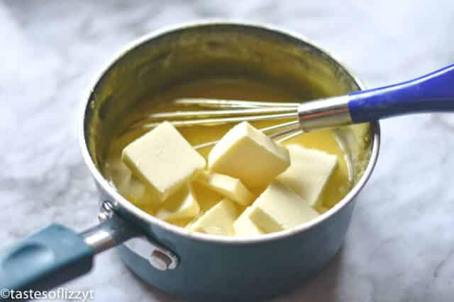 stirring ingredients to make a lemon curd recipe