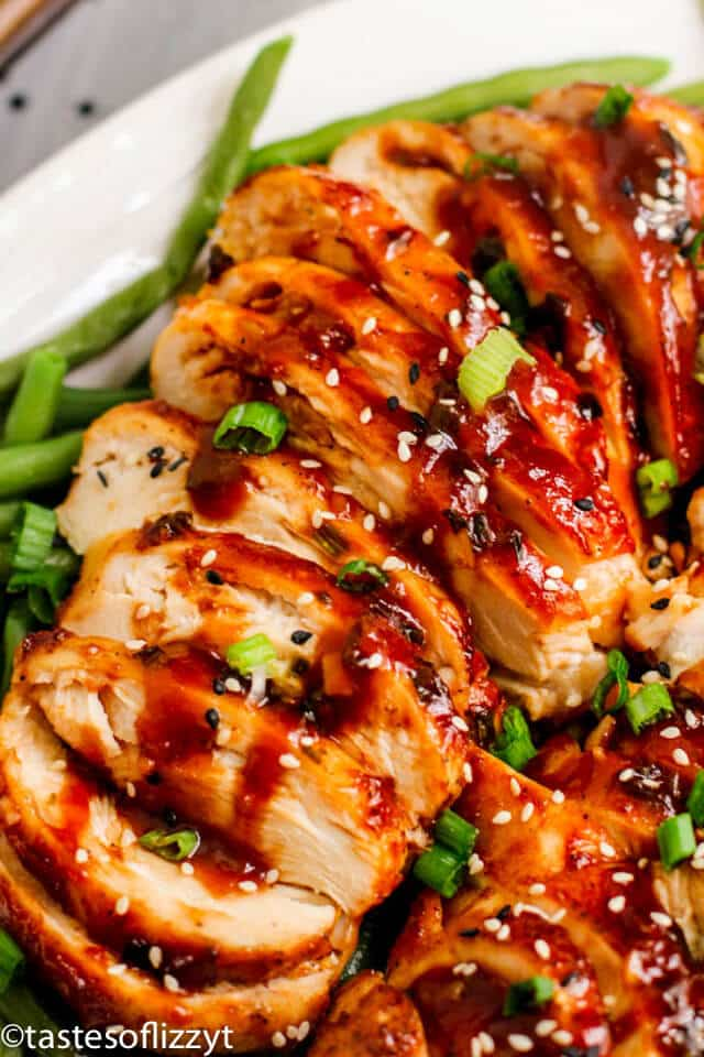 A close up of sliced chicken with sauce