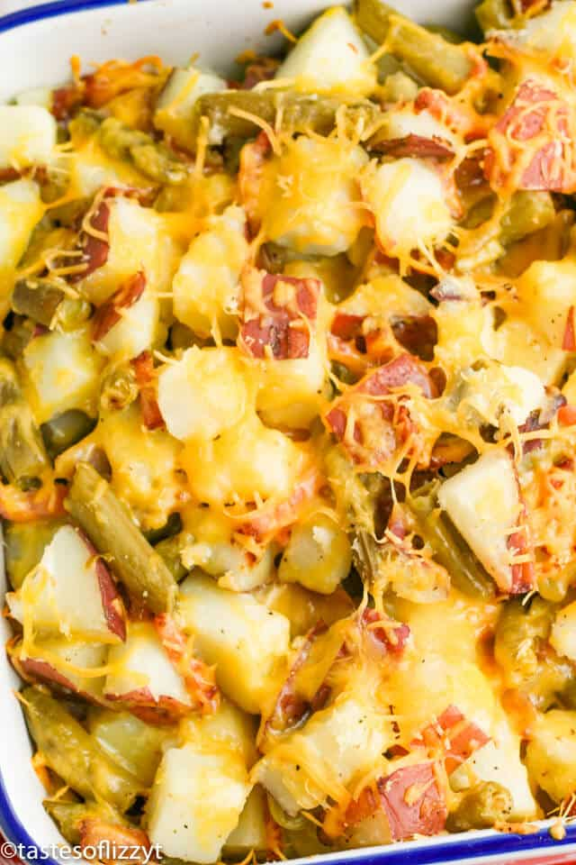 A close up of food, with Potato and green beans