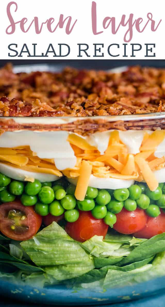 Better than traditional seven layer salad, this easy side dish recipe is high protein since it is loaded with cheese, bacon and eggs. The creamy homemade dressing has an amazing flavor. It's a layered salad perfect for picnics and potlucks. #sevenlayer #salad #layeredsalad #bacon #eggs via @tastesoflizzyt