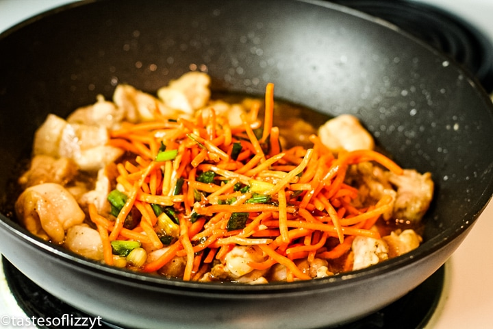 vegetables and chicken in a skillet