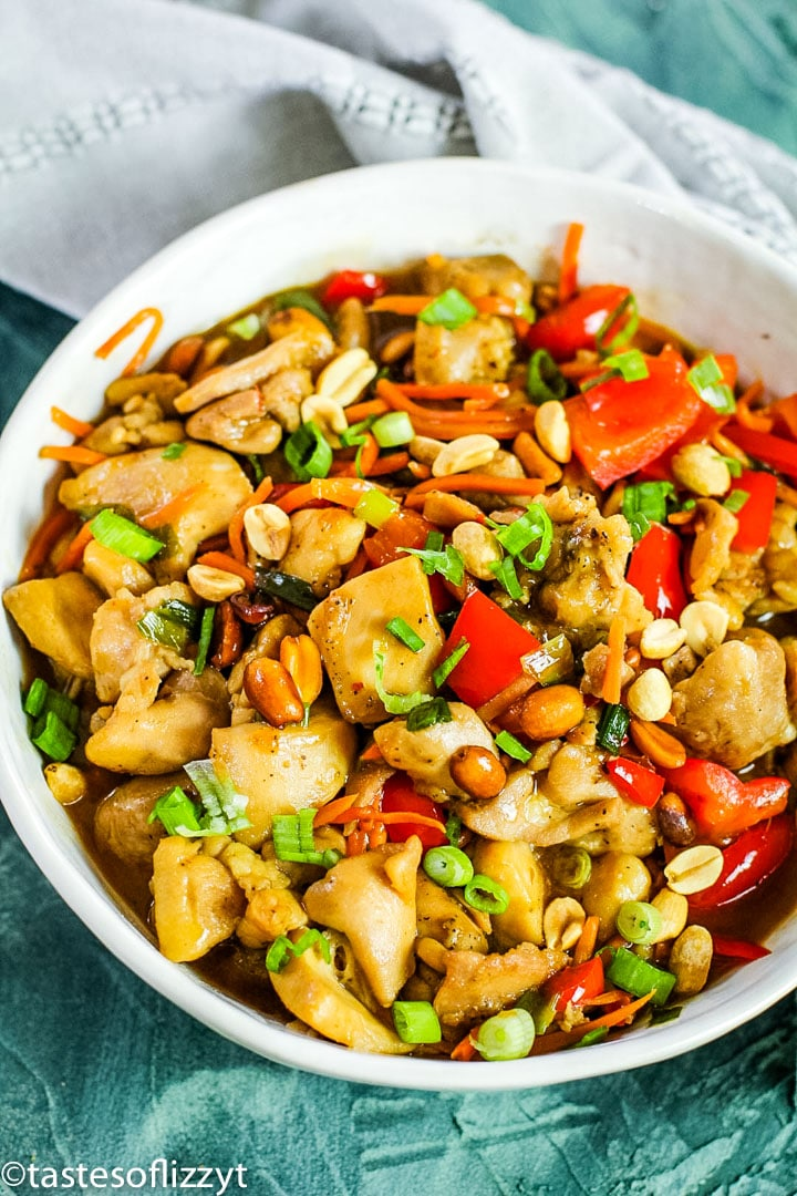 A dish is filled with food, with Kung Pao chicken