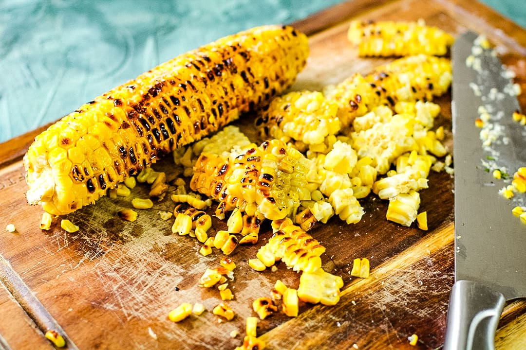 sliced grilled corn on a wooden board