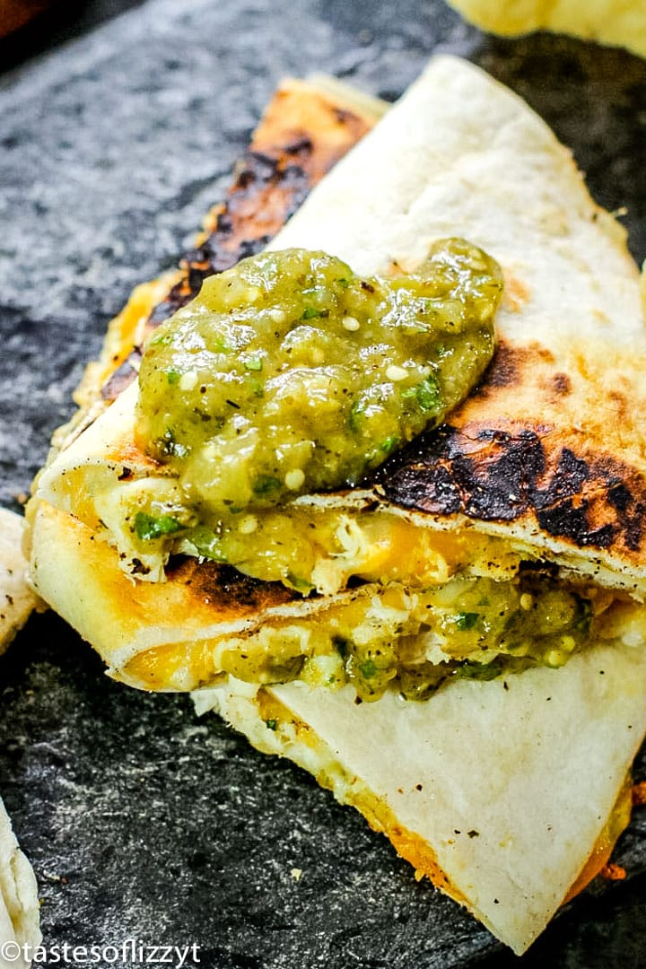 salsa verde chicken quesadilla on a slate