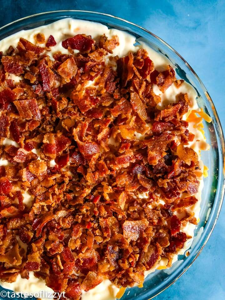bacon on top of a layered salad