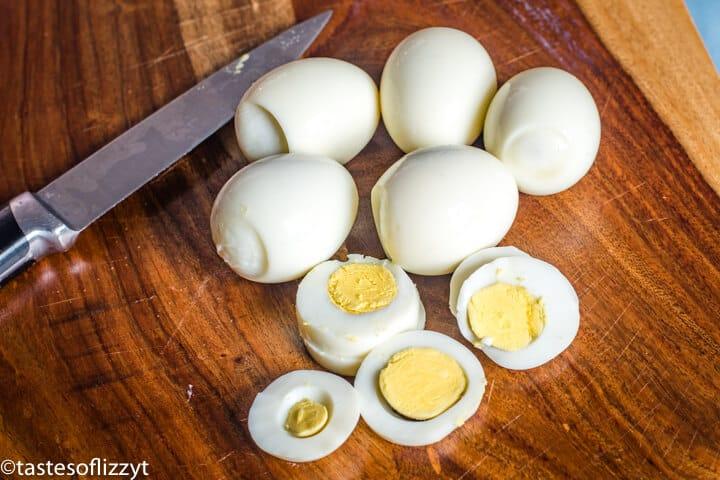 hard boiled eggs on a cutting board