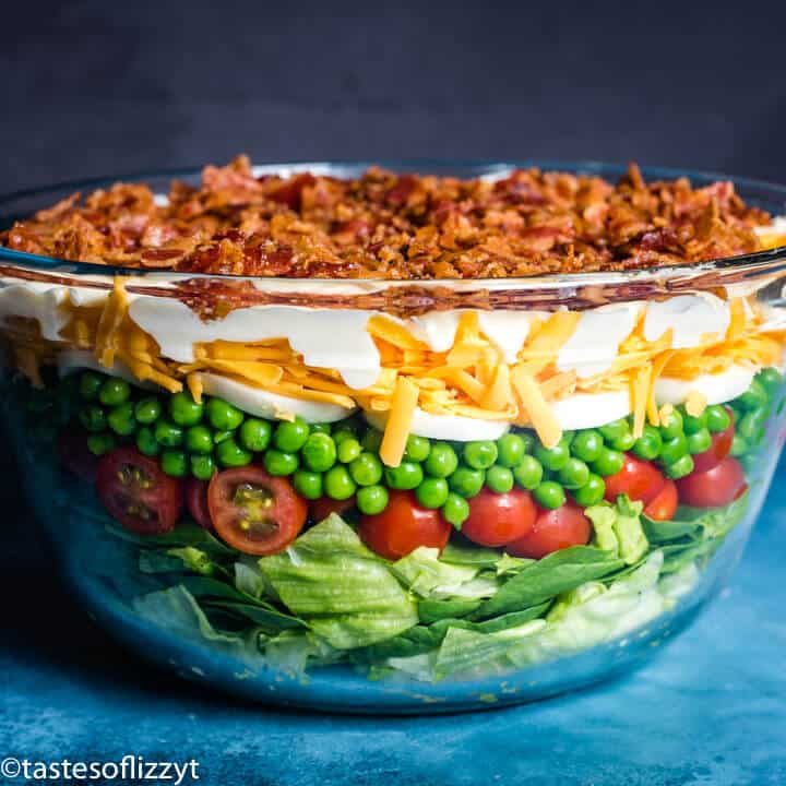 salad with 7 layers in glass bowl