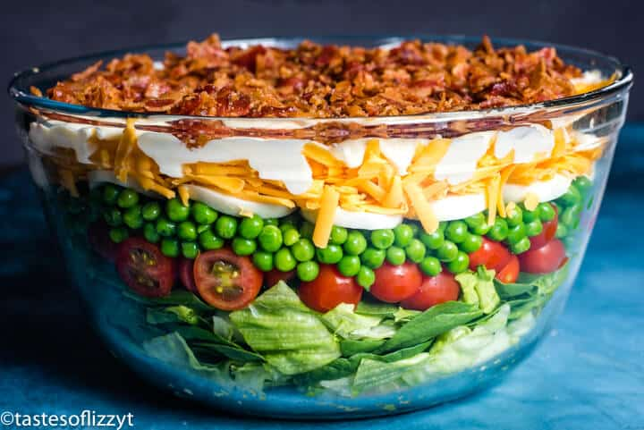 glass bowl with seven layer salad