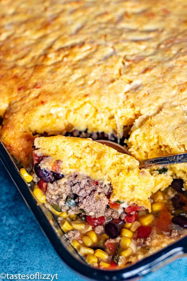 tamale pie with a serving spoon
