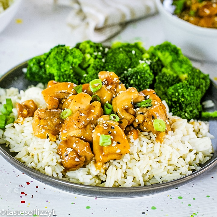 A plate of food with rice and broccoli, with Chicken and Teriyaki