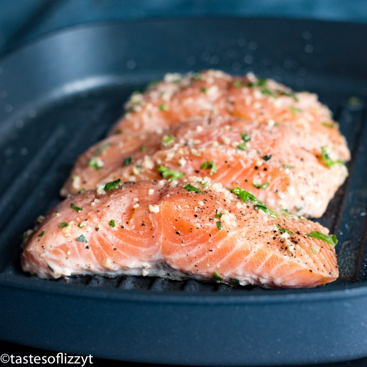 A close up of salmon in a pan