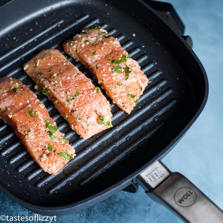 A close up of salmon on a grill