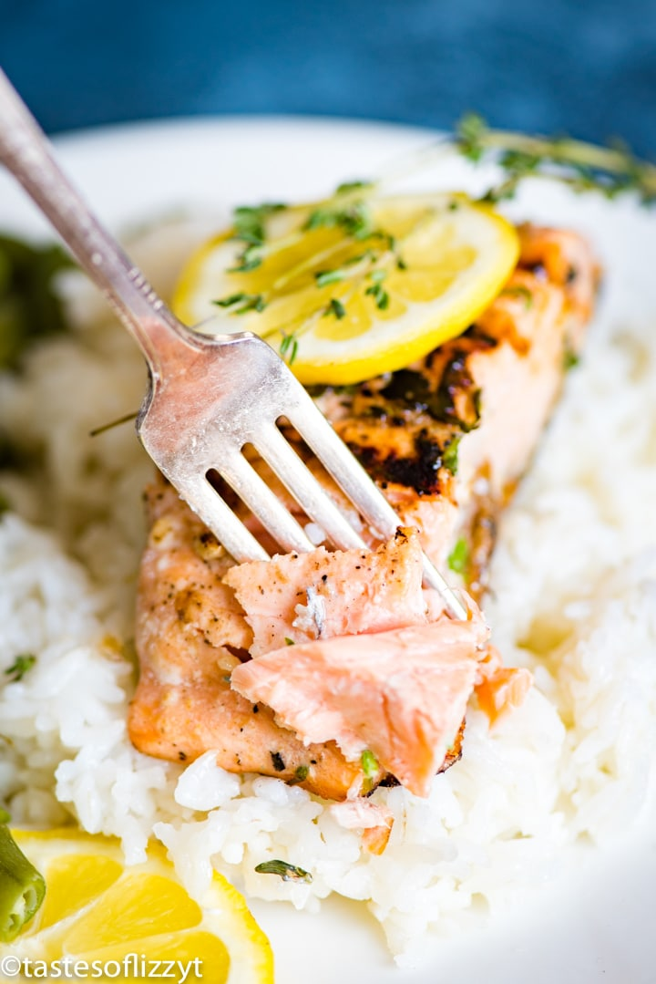 A plate of food with rice and vegetables, with Salmon