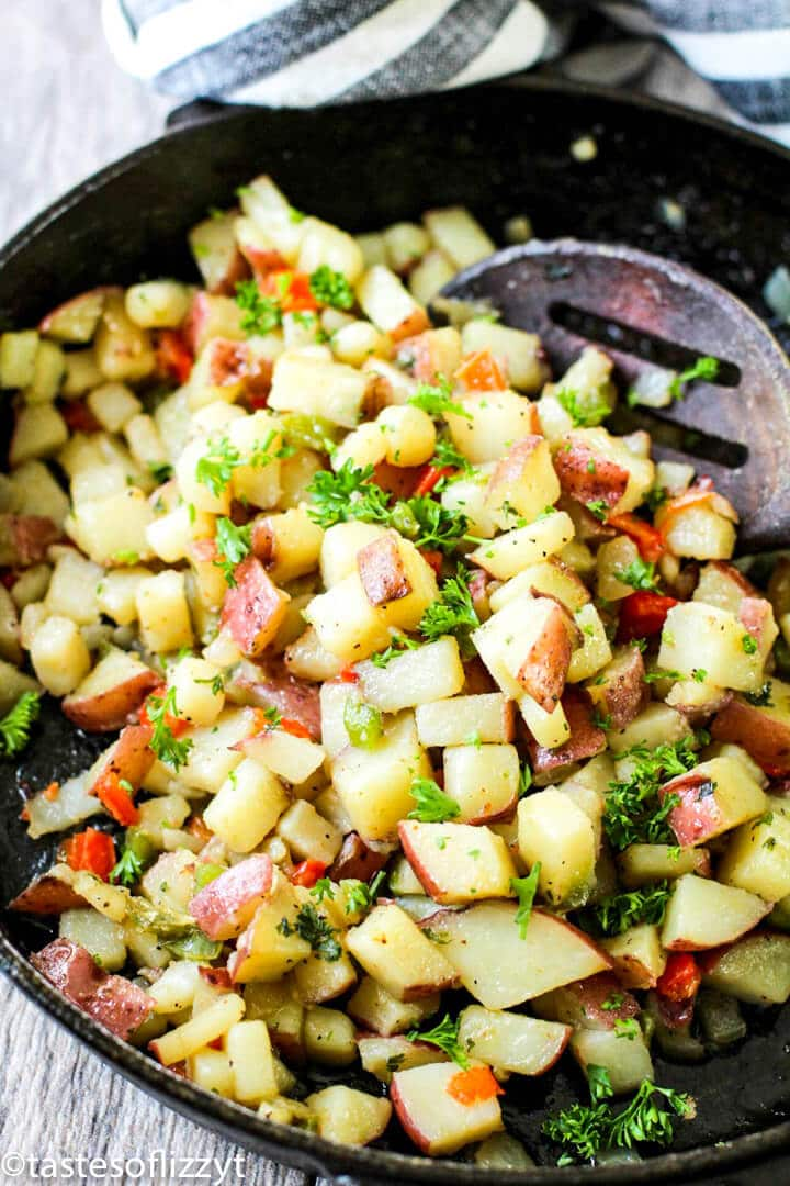 A pan filled with food, with Potatoes O\'Brien