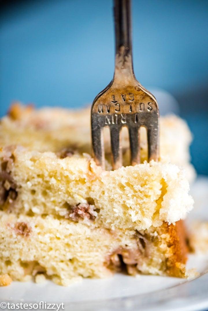 fork in a piece of rhubarb bread