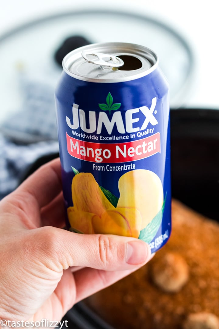 A close up of a can of mango nectar