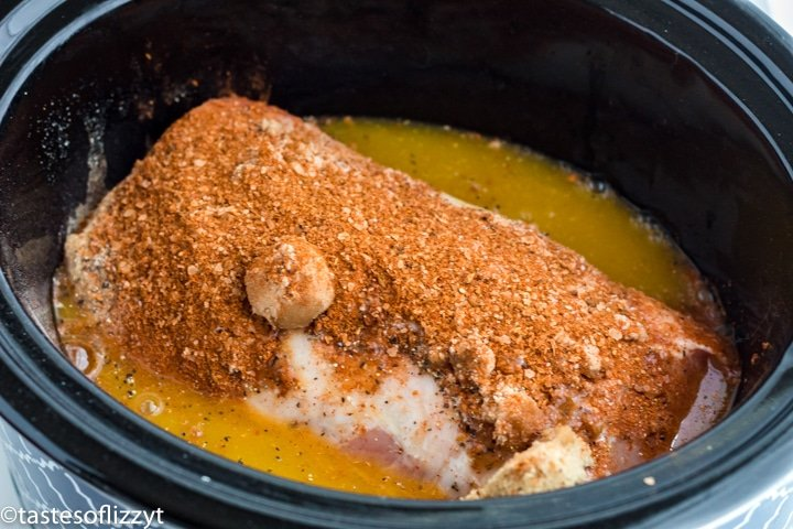 uncooked pork loin in a slow cooker