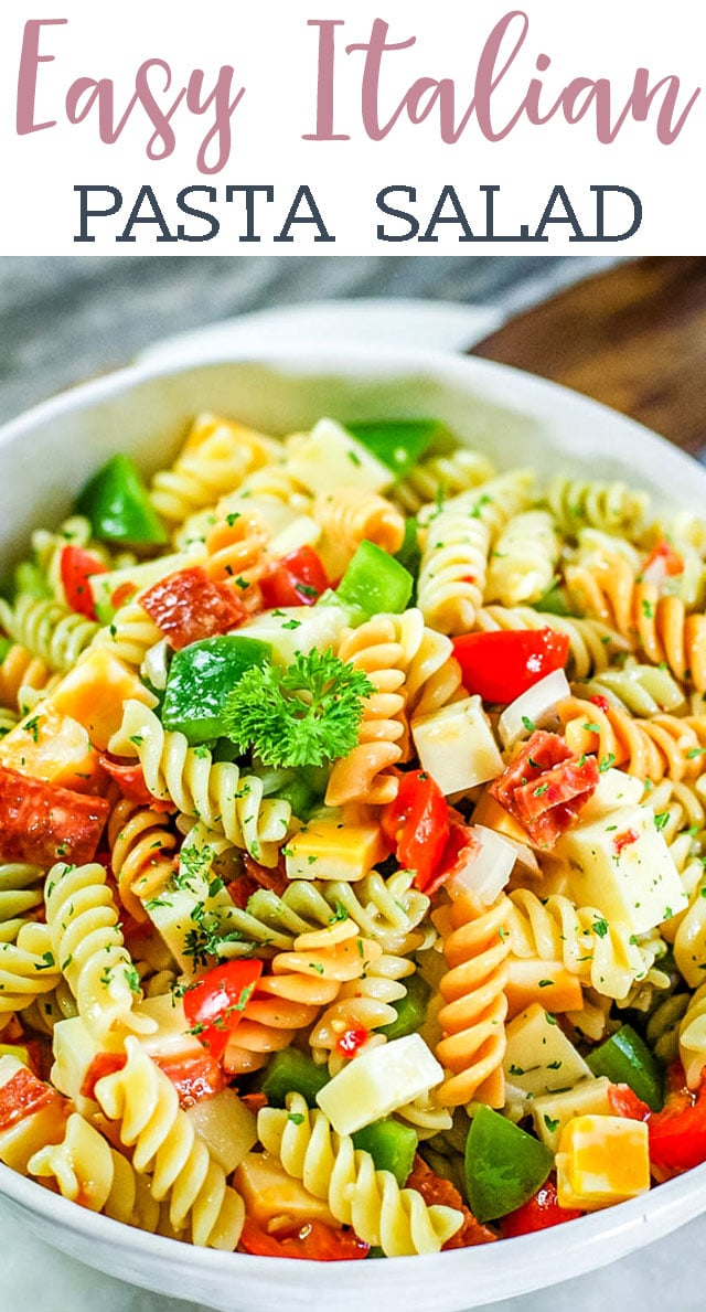 This Classic Italian Pasta Salad is summer picnic comfort food at its best. Tri-color pasta, veggies, cheese and pepperoni fill this zesty Italian salad. #salad #summer #pasta #pepperonie #italian via @tastesoflizzyt