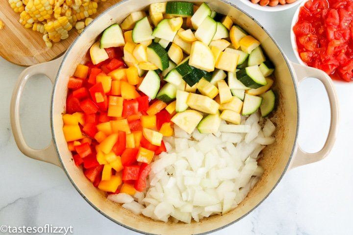 A pan of squash, peppers and onions