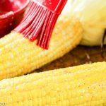 brushing butter on ear of corn