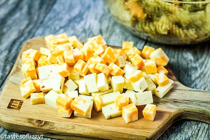 cut cheese on a cutting board