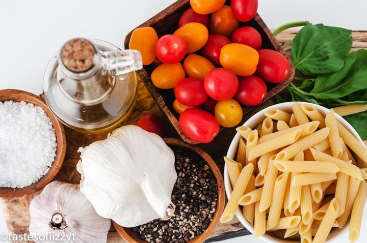 ingredients for tomato basil pasta on a table