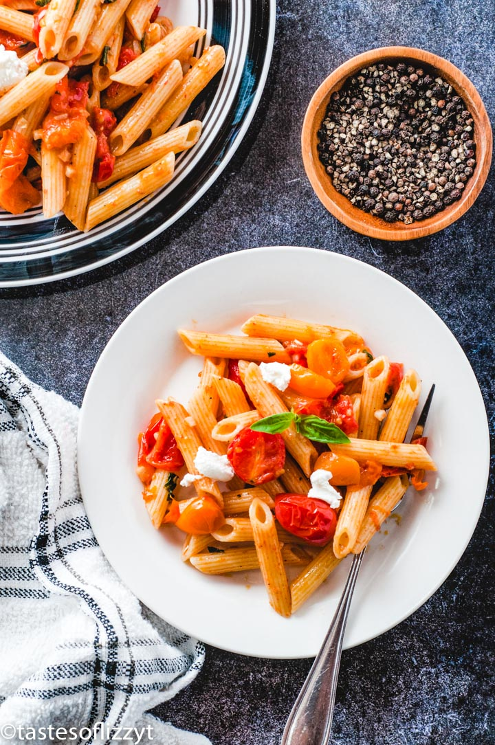 A plate of food on a table, with Pasta and Tomato