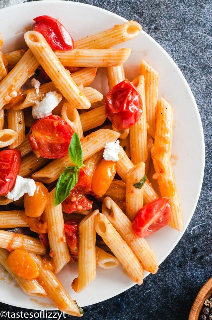 A plate of food, with Pasta and Tomato
