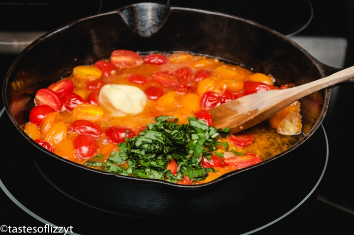 tomatoes, butter and basil in a skillet