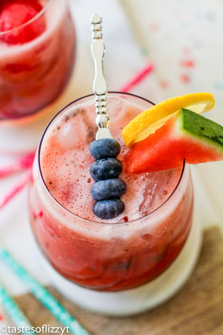 glass of watermelon agua fresca with blueberries