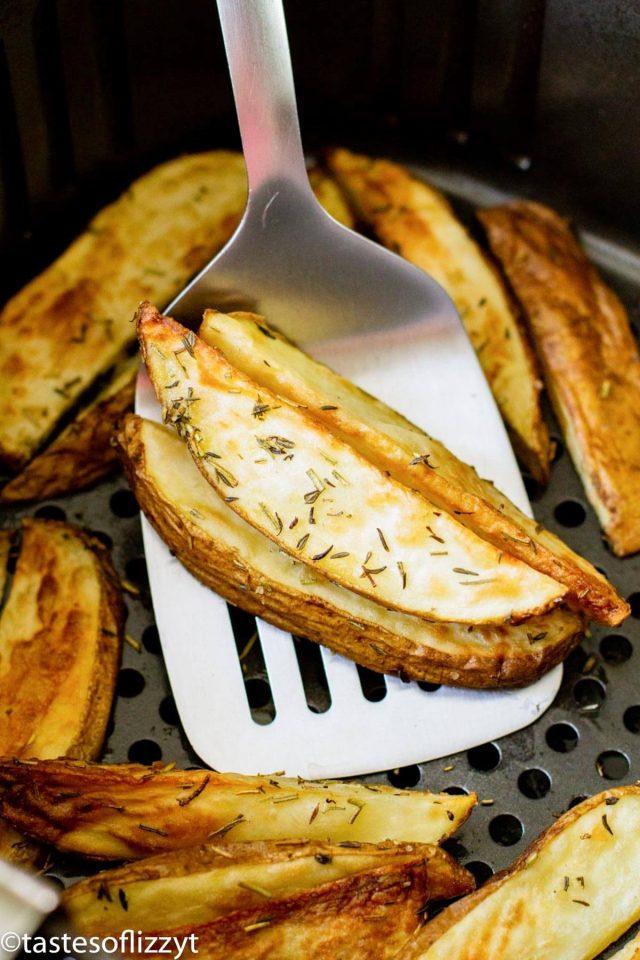 a spatula with potato wedges