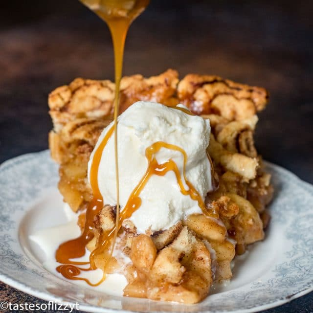 apple pie on a plate with ice cream and caramel